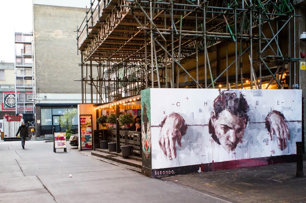 borondo-cheese-new-mural-in-east-london-uk-02