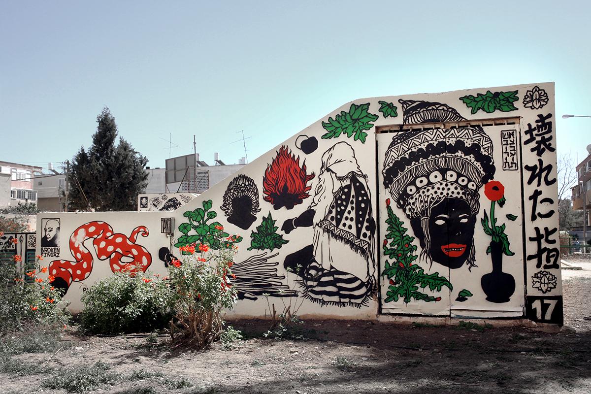 Broken Fingaz street art Arad Israel